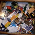cluttered desk drawer